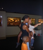 Rhona Brown enjoys one of the dioramas with a mom who brought her kids to enjoy what the Durban Natural Science Museum has on offer, KwaNunu April 2013.