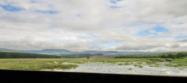 View from the bird hide showing the extent of the wetland area - to the base of the hills in the distance.